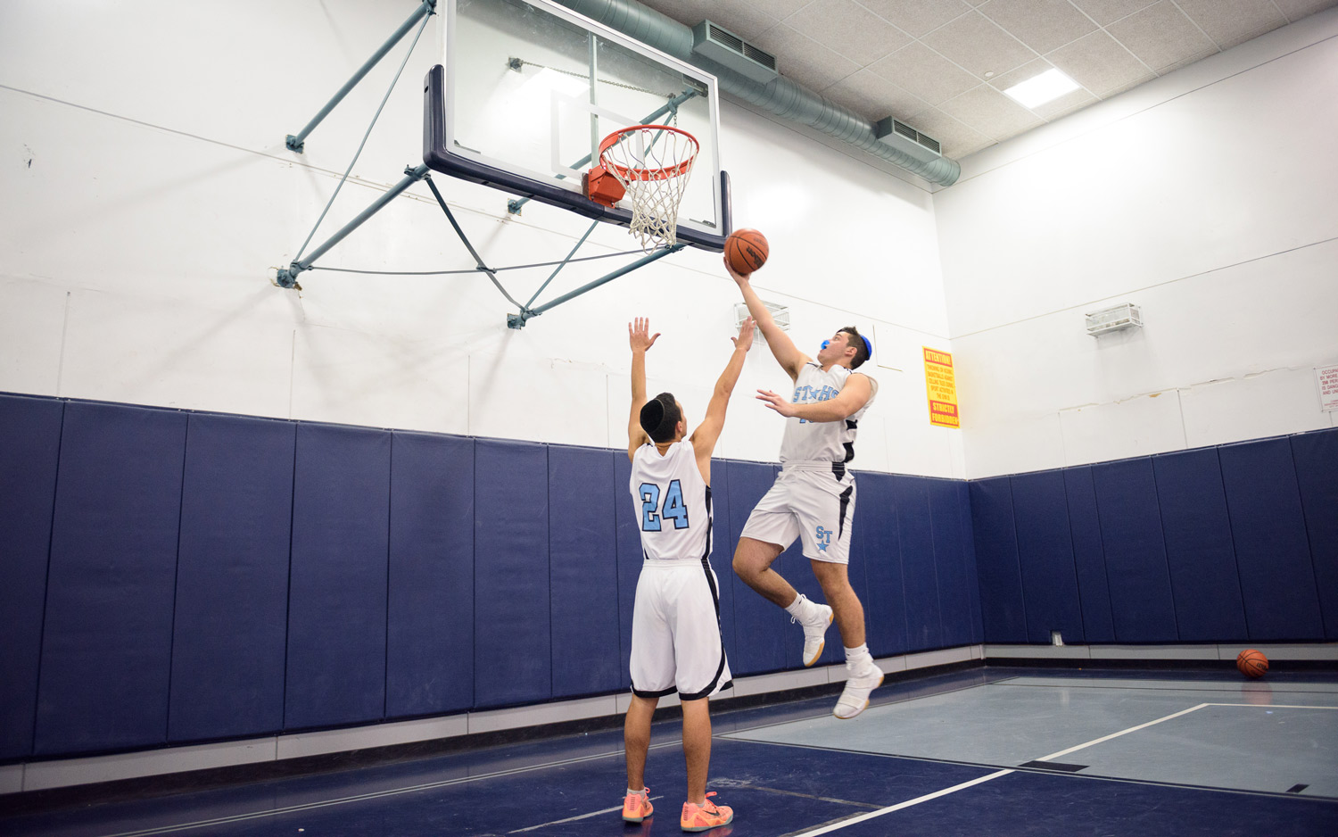 Boys High school Division students playing basketball