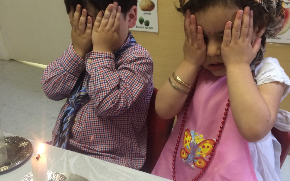 Children from the Preschool Division playing Shabbos Mommy and Tatty